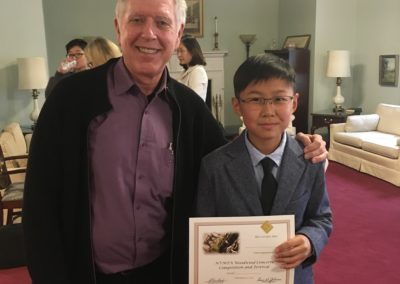 Dr. Hunt with Joey A. after he won the NVMTA Concerto Competition